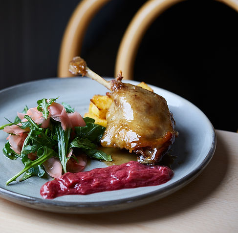 Honey & Muscat glazed Confit Duck with poached rhubarb, rocket & pickled ginger