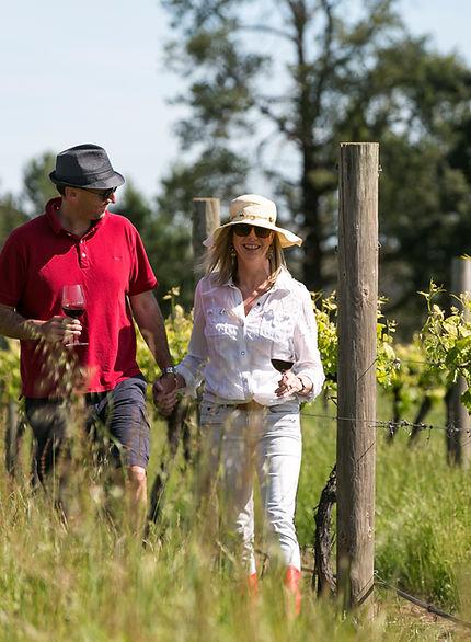 Enjoying a glass of wine in the vineyard
