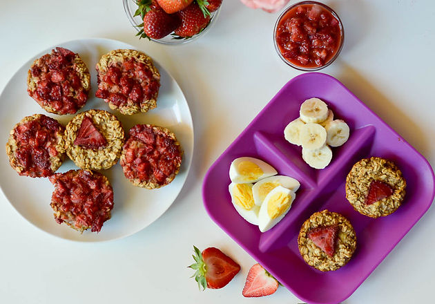 oatmeal muffins and eggs on a purple plate