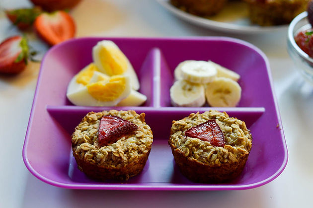 oatmeal eggs and bannanas in purple plate