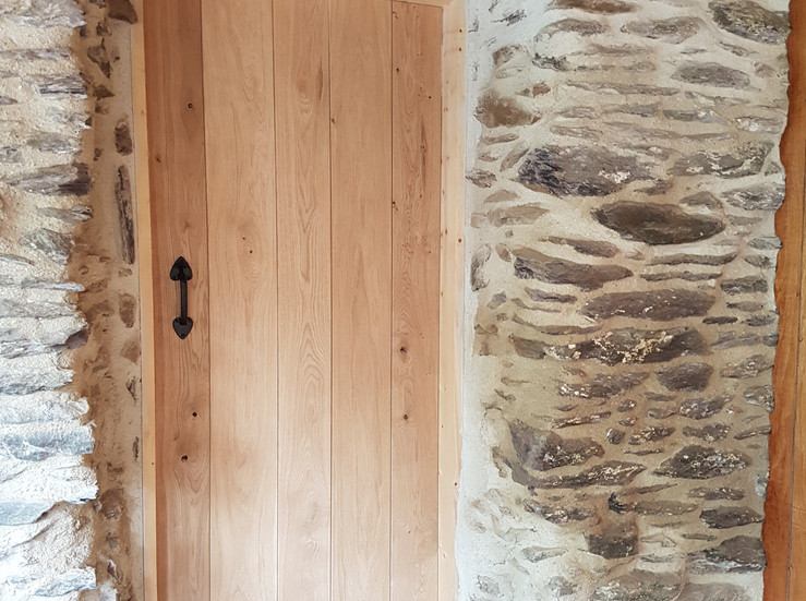 Traditional styling for the oak shower room door
