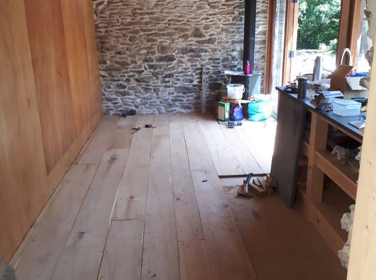 The wide planked oak floor