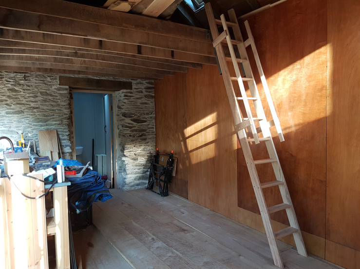 Solid ash ladder giving access to the mezzanine sleeping platform