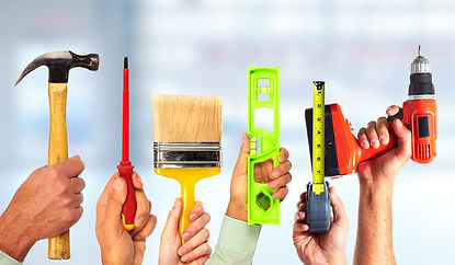 bigstock-Hands-of-handyman-with-tools--1