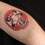Daruma doll tattoo
