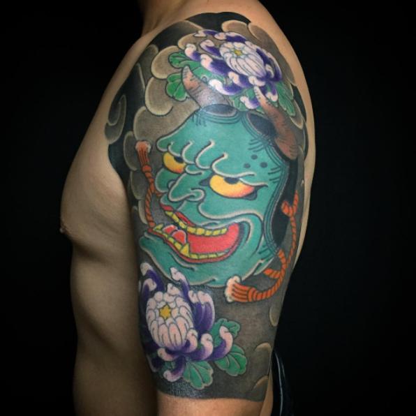Hannya mask sleeve tattoo