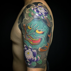 Hannya mask sleeve tattoo