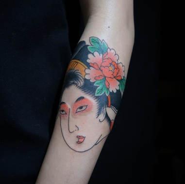 Geisha head tattoo
