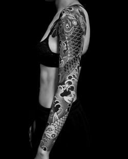 Koi fish sleeve tattoo