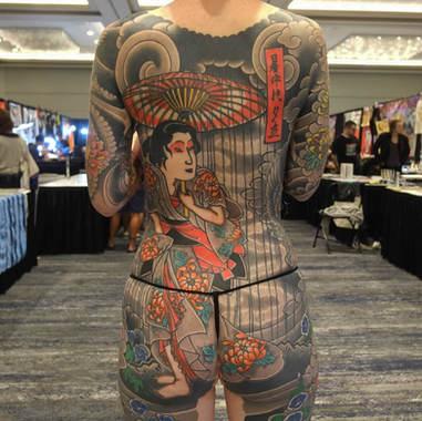 back piece woman tattoo