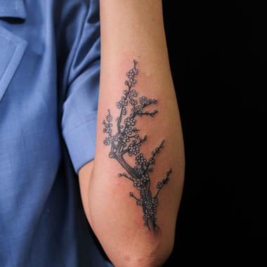 Plum branch tattoo