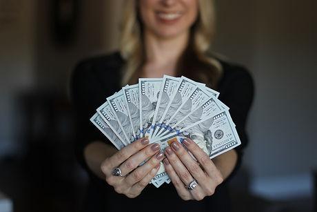 Canva - Wealthy Woman Showing Money.jpg