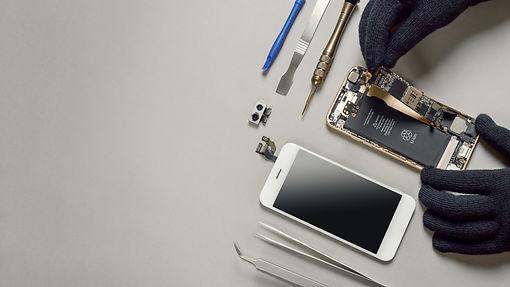 technician-repairing-broken-smartphone-d