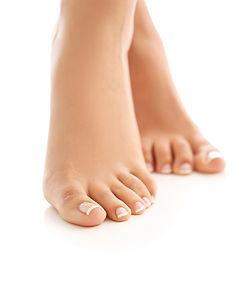 female-bare-feet-skin-care-and-pedicure-