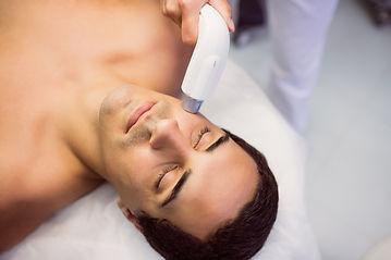 man-getting-facial-massage-at-clinic.jpg