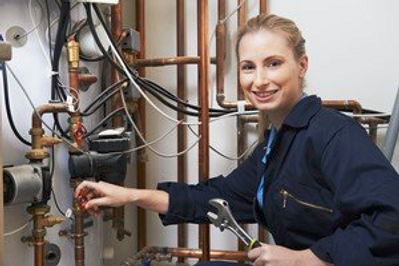 girl fixing pipes.png