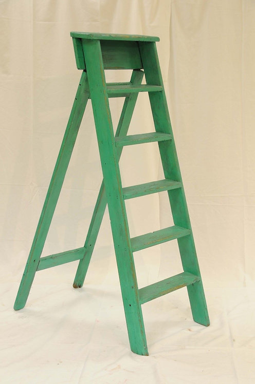 Decorative wooden ladders, painted green