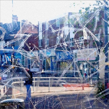 Stephen Calcutt has used the graffiti etched windows of bus shelters as a lens for his street photography