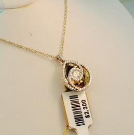 Swirling typhoon diamond pendant