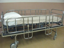 Older stainless steel bed