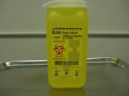 Small yellow needle dispenser