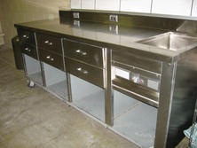 Stainless steel table with sink and drawers