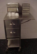 Stainless steel table with side shelf and drawers