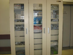 Modern supply cabinet with glass doors