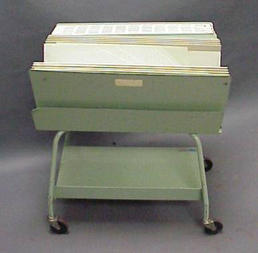 Older green metal file chart cart