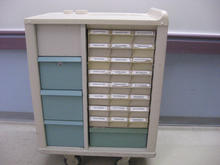 Grey drug cart with blue drawers