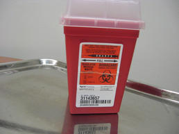 Small red needle dispenser