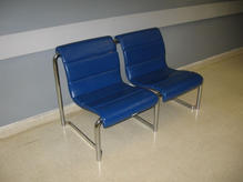 Two attached blue leather chairs