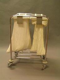 Older white cloth soiled linen cart