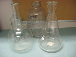 Box of clear lab bottles