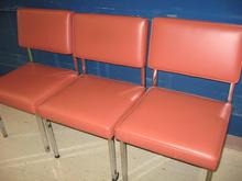 Orange waiting room cahirs