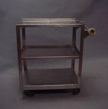 Stainless steel mobile table with two shelves
