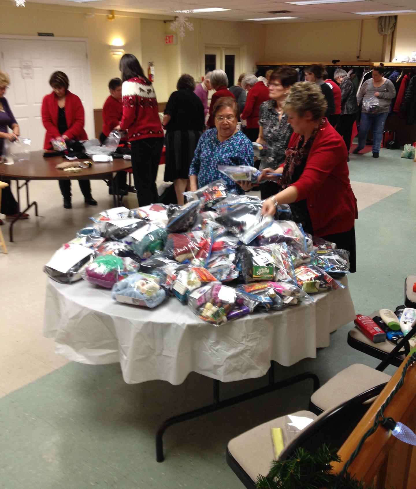 CWL Ladies pack bags for needy