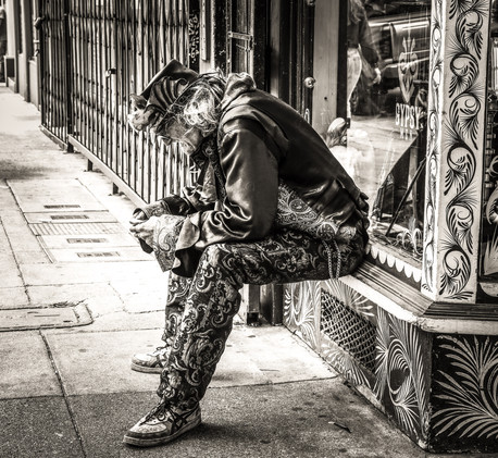 The man chilling in the street