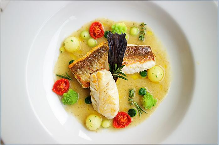 Tub gurnard on a fish soup with lemon and basil