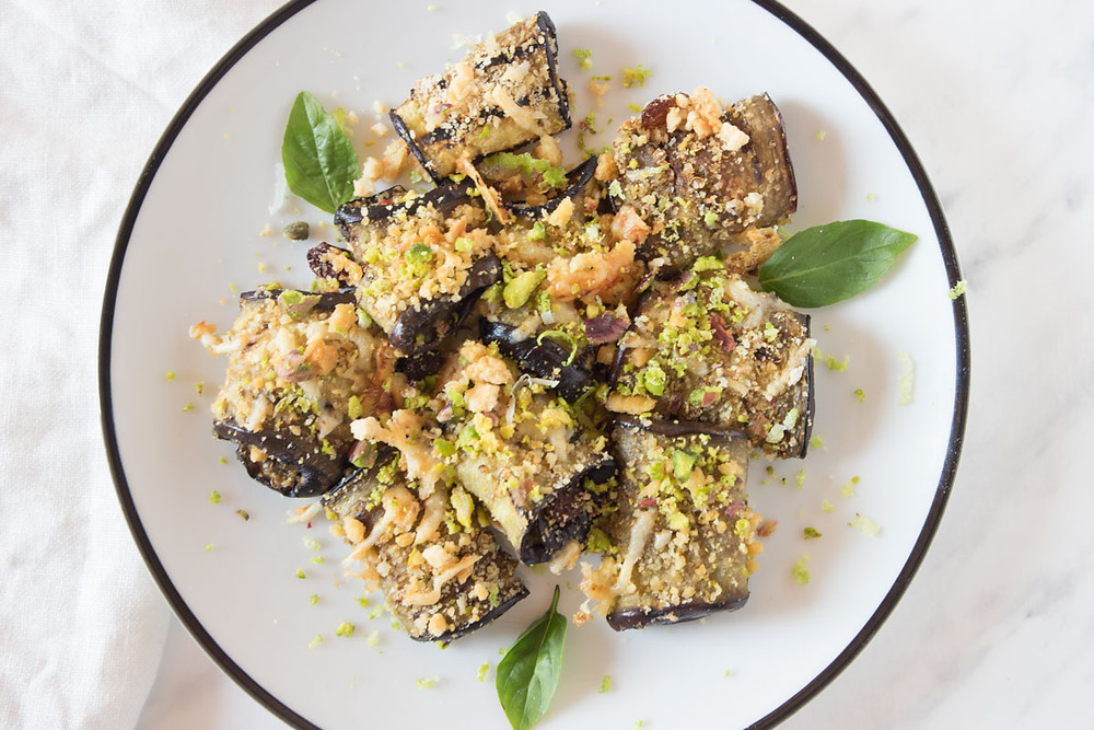 Aubergines beccafico with pistachios, Parmesan, breadcrumbs and lemon zests