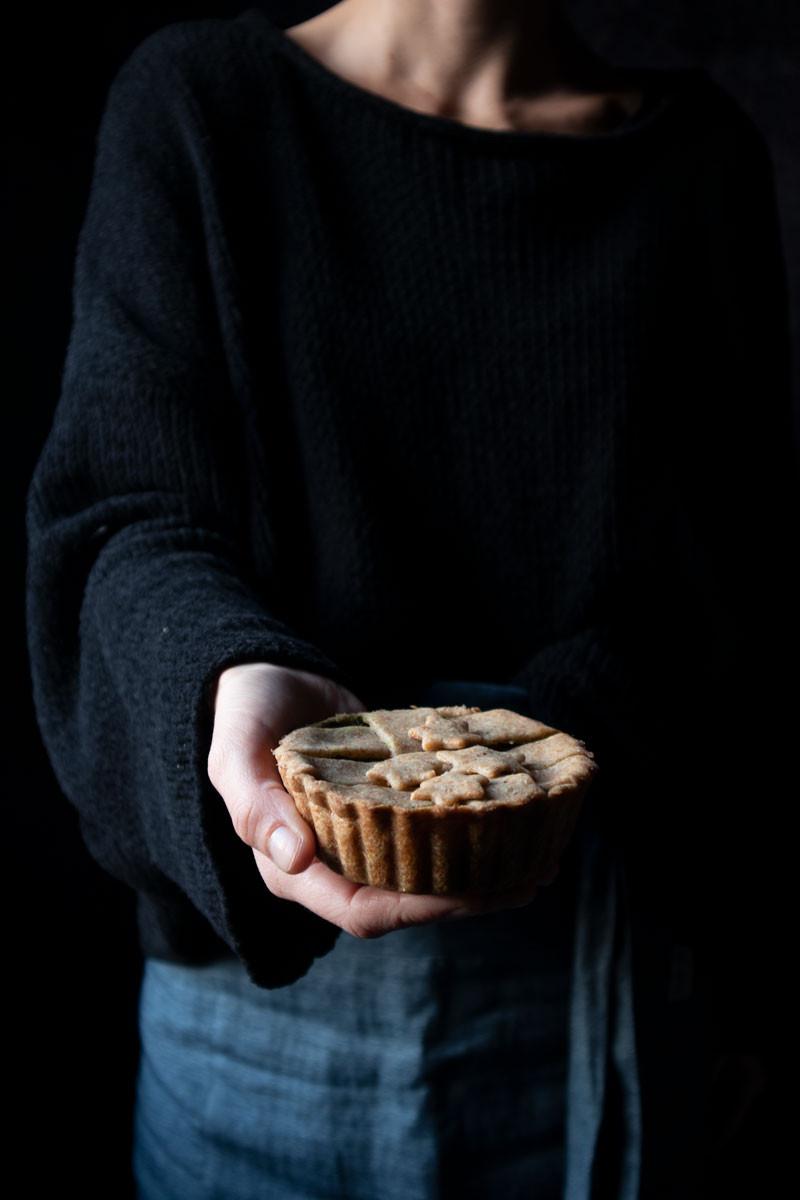 Vegetarian whole wheat mini tarts with kale, pesto and ricotta