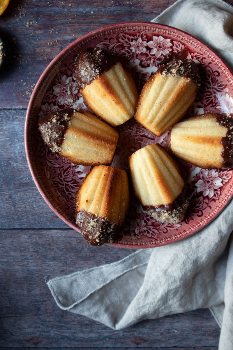 Citrus scented Madeleines with dark chocolate and nuts