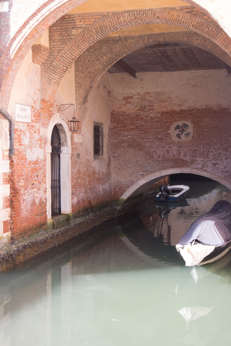 San Marco | Covered shelter for boats beneath the Santo Stefano church