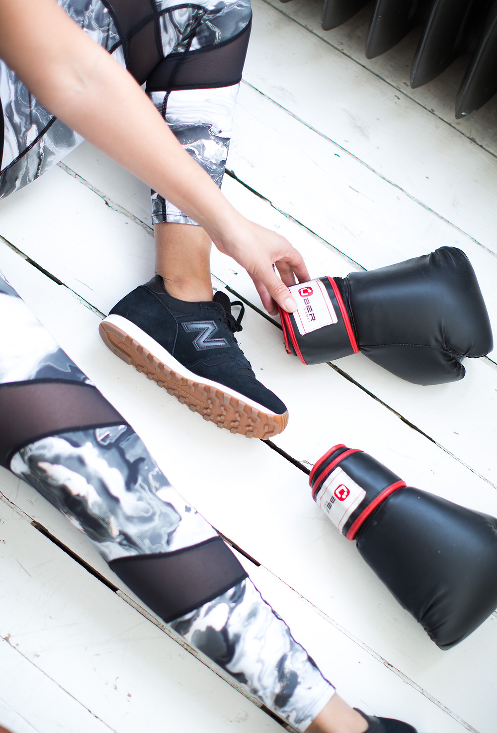exercise leggings of mesh and marble print from house of Fraser worn by Natalie from Style Me Sunday pictured with a pair of boxing gloves and New balance trainers