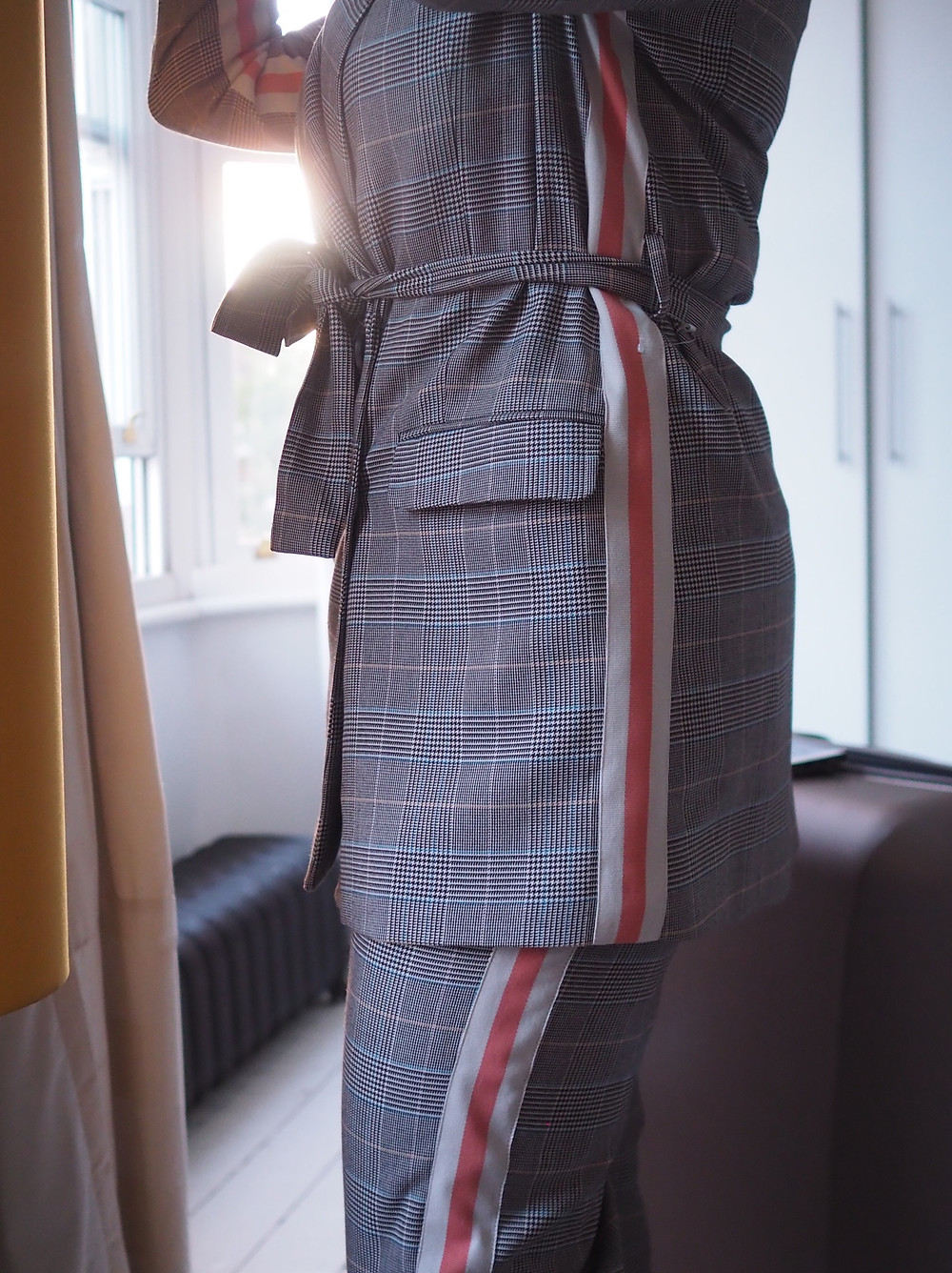 A close up picture of my side profile, wearing an M&S checked suit with side stripe detail, and a co-ordinating belt.