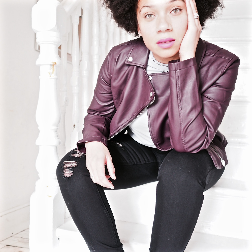 Introducing the new fashion collection from Avon. nat from Style Me Sunday wears a burgundy leatherette biker jacket, black ripped jeans and a grep keyhole blouse