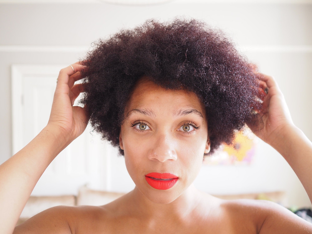 Nat showing her afro hair after dying it with Clairol nice & easy - dark burgundy brown