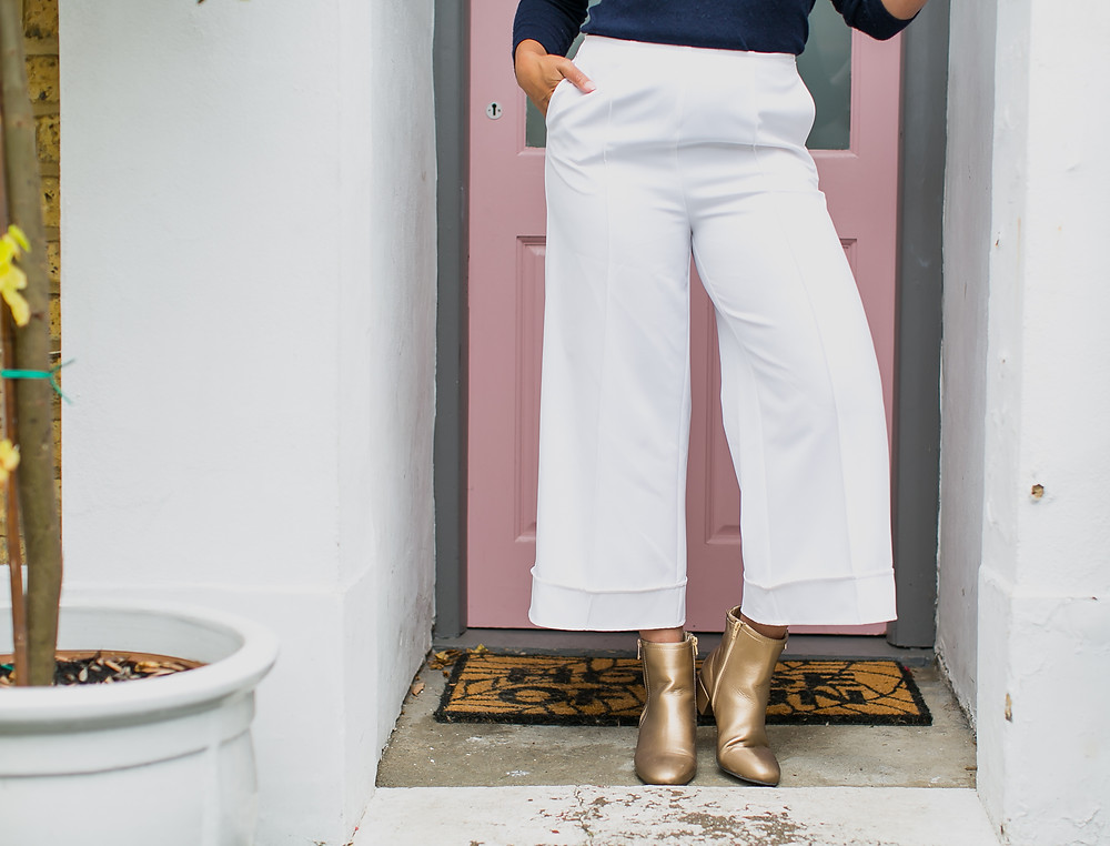 White cropped trousers by M&S and gold boots by M&S modelled by Style Me Sunday