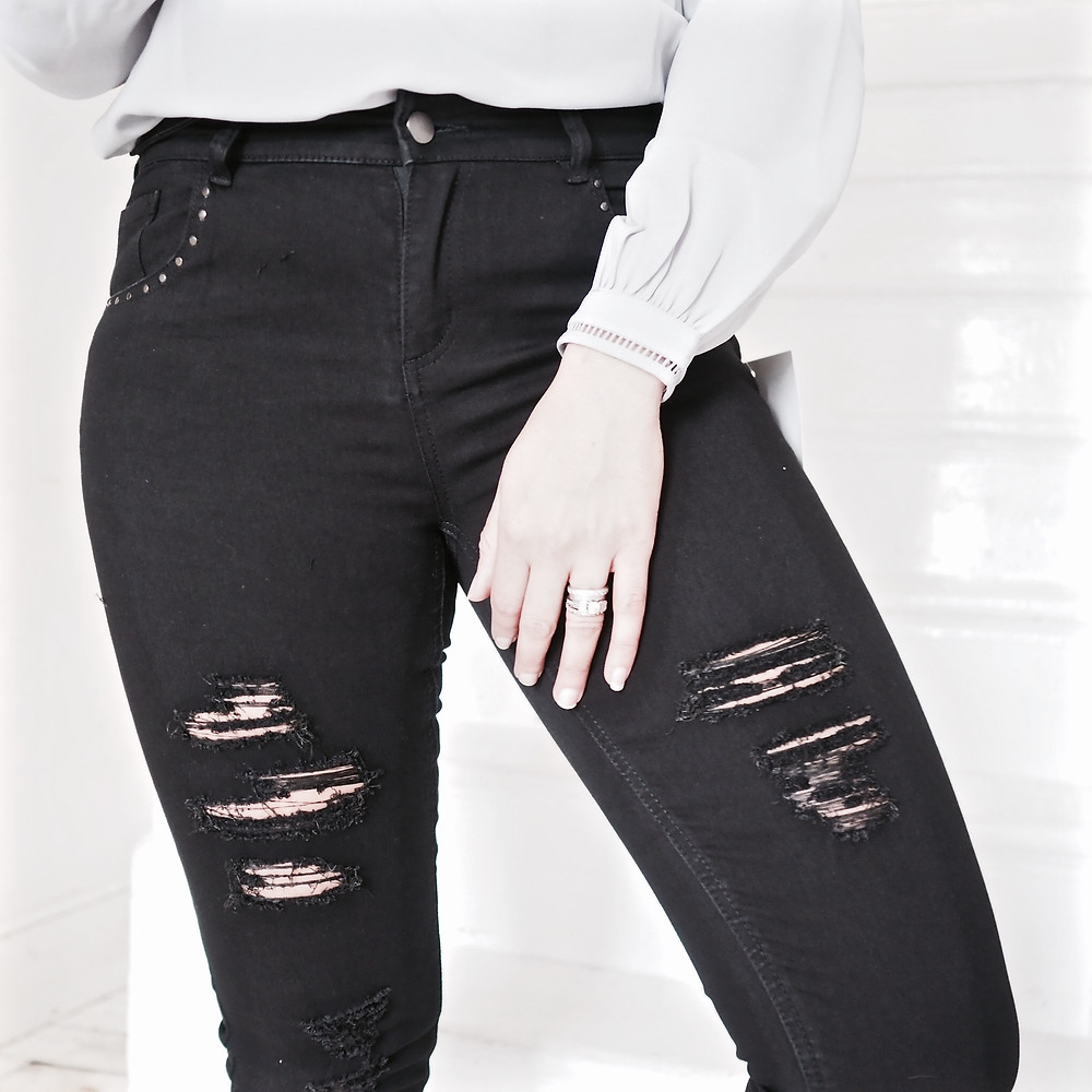 Ripped black denim jeans from Avon worn by Nat from Style Me Sunday
