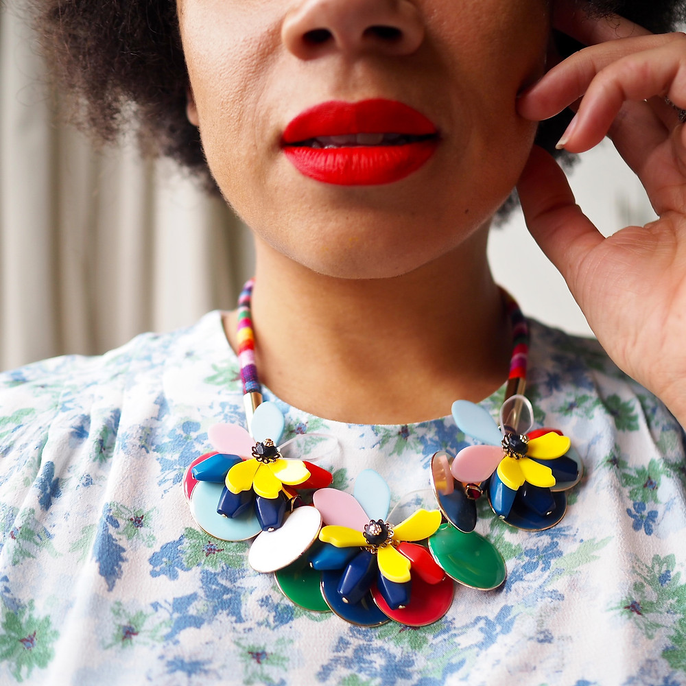 A close up of a very colourful floral statement necklace